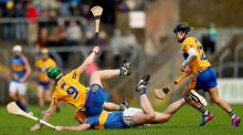 Clare's Tony Kelly and Padraic Maher of Tipperary take a tumble in Ennis. Photograph: James Crombie/Inpho