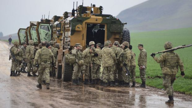 A convoy of Turkish armoured personnel carriers near the border with Syria. Photograph: AP