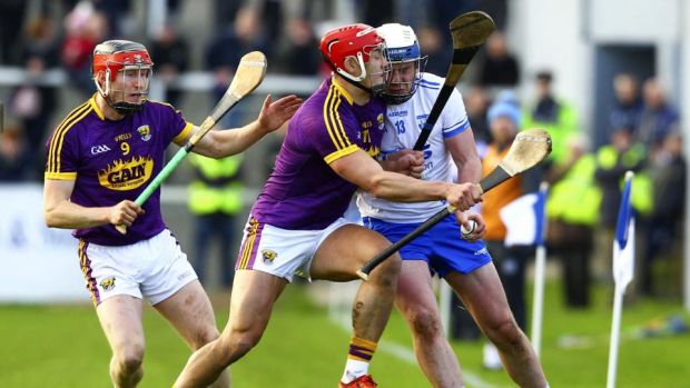 Waterford's Stephen Bennett is tackled by Wexford's Lee Chin during the Allianz Hurling League Division 1A match at Walsh Park. Photograph: Ken Sutton/Inpho