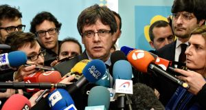 "Carles Puigdemont: Madrid fears the politician may sneak across the border with France ""in a helicopter, in a boat or in the boot of a car"". Photograph: John Thys/AFP/Getty"