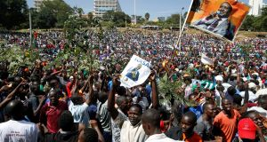 Supporters of Kenyan opposition leader Raila Odinga of the National Super Alliance (Nasa) coalition gather ahead of Mr Odinga's planned 'swearing-in' ceremony at Uhuru Park in Nairobi on Tuesday. Photograph: Baz Ratner/Reuters