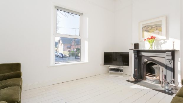 244 Merrion Road, Dublin 4: The livingroom to the front has painted white floorboards and white walls