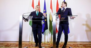 Hungarian prime minister Viktor Orban and  Austrian chancellor Sebastian Kurz  at a press conference after their meeting in Vienna. Photograph: Lisi Niesner/EPA