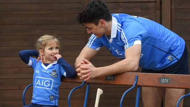 Dublin hurler Danny Sutcliffe with young Dub, Clodagh Quinn, age 4, in Parnell Park to kick off the 2018 Dublin GAA Season. Photograph by David Fitzgerald/Sportsfile