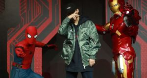 Rapper PG One (centre). Chinese music fans are bracing for a crackdown on hip-hop after a rapper was dropped from a popular singing programme. Photograph: Getty Images/AFP