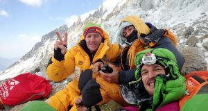 French climber Elisabeth Revol (centre) poses with rescuers Denis Urubko (left) and  Adam Bielecki at the base of Nanga Parbat mountain in Pakistan. Photograph: Adam Bielecki