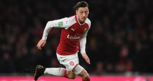 Mest Ozil has signed a new three-year contract with Arsenal. Photo: Shaun Botterill/Getty Images