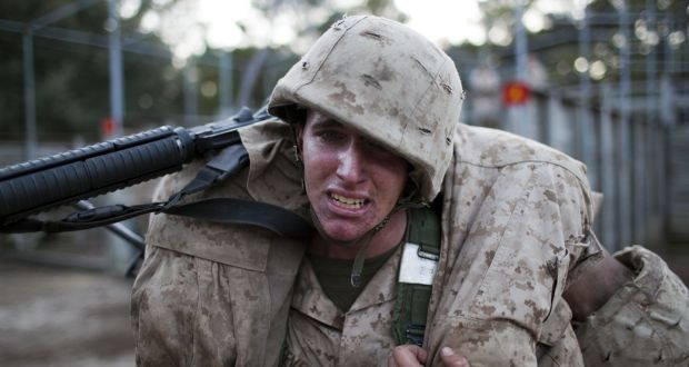 A US marine corps recruit training at Parris Island in South Carolina. One study found marines who failed basic training could pass when supported by a buddy system. Photograph: Robert Nickelsberg/Getty Images