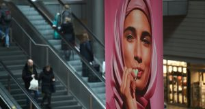 An ad for vegetarian sweets features a Muslim woman in a headscarf at Hauptbahnhof railway station in Berlin. Photograph: Sean Gallup/Getty Images