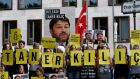 Amnesty activists protest against  detention of Taner Kilic. Photograph: AFP/ John Macdougall