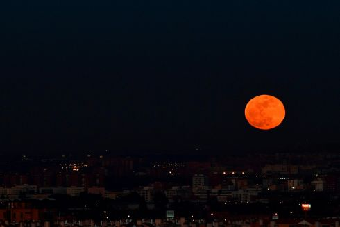 SPANISH MAIN: The Moon rises over Madrid, Spain. Photograph: Pierre-Philippe Marcou/AFP/Getty Images