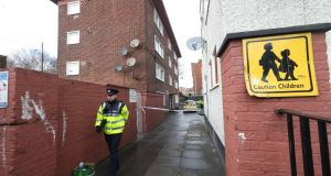 A garda at the scene in the James Larkin House flats complex off North Strand where Jason Molyneux  was shot dead on Tuesday night. Photograph: Niall Carson/PA Wire