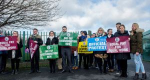 Teachers  during a lunchtime protest outside Greenhills College, Dublin over pay inequality. Photograph: Brenda Fitzsimons