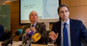Tony O'Brien, director general of the HSE, with Minister for Health Simon Harris at the announcement of the HSE National Service Plan 2018 in December. Photograph: Brenda Fitzsimons