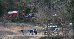 French gendarmes and firefighters  work at the site of an accident near Carces lake, about 50 kilometres northwest of the resort of Saint-Tropez, on February 2nd, 2018, after two army helicopters crashed into each other. Photograph: ANNE-CHRISTINE POUJOULAT/AFP/Getty Images