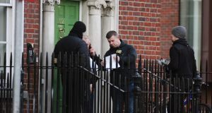 A security team arrive with a locksmith to change certain apartment door locks and display a Highcourt notice to apartment no 27, 52 Mountjoy Square.Photograph: Padraig O'Reilly.