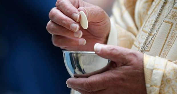 The Health Protection Surveillance Centre (HPSC) says  receiving Holy Communion directly on the tongue 'should be discouraged' during flu season. Photograph: Getty Images
