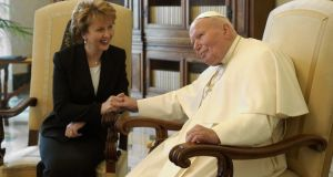 Pope John Paul II holds the hand of Irish President Mary McAleese during their meeting in  2003 in the Vatican. File Photograph:  Arturo Mari-Vatican Pool/Getty Images