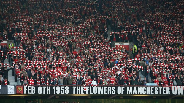 Manchester United fans pay tribute to the Busby Babes on the 50th anniverary of the Munich Air Disaster. Photograph: Alex Livesey/Getty