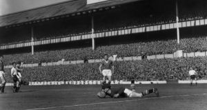 Harry Gregg makes a save for Manchester United in August 1958. Photograph: Getty