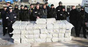 Armed Naval and Garda personnel with the cocaine which was seized from a yacht off the west coast of Ireland, in the harbour at Castletown Bere in Co Cork in 2008. Photograph: Niall Carson/PA Wire