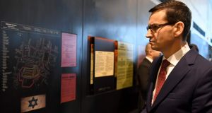 Polands Prime Minister Mateusz Morawiecki visits on January 2nd, 2018 the Ulma Family Museum that is documenting the fate of the Polish Ulma family, killed in March 1944 by Nazi Germans for rescuing Jews during the Holocaust, in the village of Markowa, southeastern Poland. Photograph: JANEK SKARZYNSKI/AFP/Getty Images