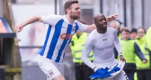 Kilmarnock's Youssouf Mulumbu celebrates scoring against Celtic in the Scottish Premiership game at Rugby Park. Photograph:   Jeff Holmes/PA Wire