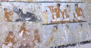 An image taken from video  shows wall paintings inside a 4,400-year-old tomb near the pyramids outside Cairo, Egypt. The  Antiquities Ministry announced the tomb's discovery on Saturday. Photograph: APTN/AP Photo