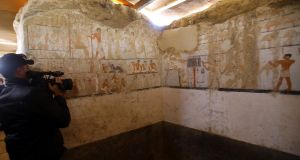 A cameraman films wall paintings in the tomb of a high-ranking female official known as Hetpet, of the 5th Dynasty  of ancient Egypt, on the Giza plateau on the southern outskirts of Cairo. Photograph: Khaled Elfiqi/EPA