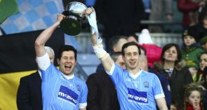 Sean Cavanagh and Colm Cavanagh raise the All-Ireland intermediate trophy. Photograph: Ken Sutton/Inpho