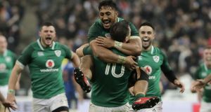 Bundee Aki celebrates with Johnathan Sexton. Photograph: Thomas Samson/AFP