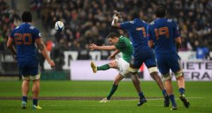 Jonny Sexton drops a long-range goal to  for Ireland in the final play of the game to secure a victory against France. Photograph: Mike Hewitt/Getty Images