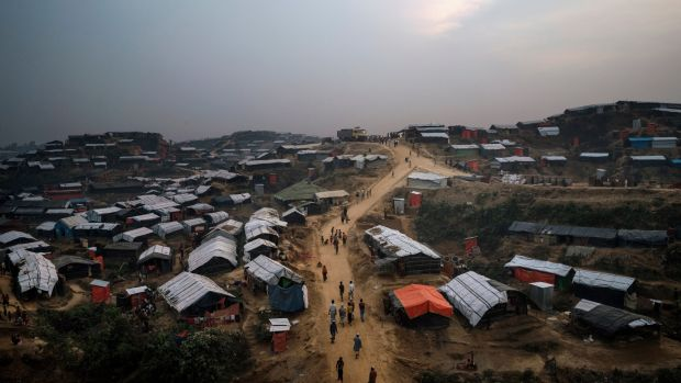 Rohingya refugees walk through the Kutupalong refugee camp in Cox's Bazar, Bangladesh, in November 2017. Photograph: Adam Dean/New York Times