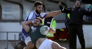 Kildare's Fergal Conway is fouled by Neil McAdam of Monaghan during the Allianz Football League Division One match in  Newbridge. Photograph: Lorraine O'Sullivan/Inpho