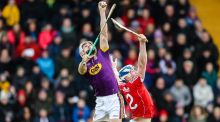 Wexford's Cathal Dunbar claims the sliotar from Cork's Seán O'Donoghue during the Allianz Hurling League Division 1A match at  Innovate Wexford Park. Photograph: Laszlo Geczo/Inpho