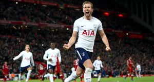 Harry Kane celebrates scoring Tottenham's late equaliser at Anfield. Photograph: Clive Brunskill/Getty