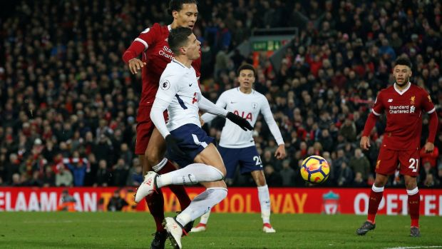 Virgil van Dijk fouls Erik Lamela to give Spurs a last minute penalty at Anfield. Photograph: Andrew Yates/Reuters