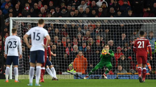 Loris Karious saves Harry Kane's first penalty at Anfield. Photograph: Michael Regan/Getty