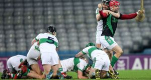 Kanturk's players celebrate at the final whistle. Photograph: Gary Car/Inpho