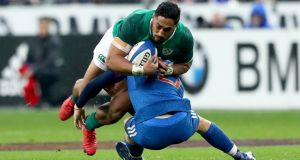 Ireland's Bundee Aki is tackled by France's Matthieu Jalibert  of France  in the Six Nations round one match on Saturday. Jalibert partially ruptured a knee ligament in the tackle. Photograph: James Crombie/Inpho