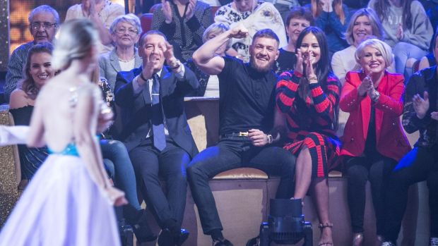 Conor Mc Gregor with his partner Dee watching his sister Erin during the fifth live show of Dancing with the Stars. Photograph: Kyran O'Brien/RTÉ