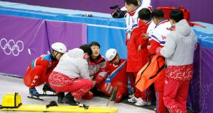 North Korea's short track speed skater Choe Un Song is injured after falling on the ice at the Gangneung Ice Arena. Photograph: Kim Hong-Ji