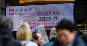 Asian markets tumbled on Monday after US stocks were pummelled at the end of last week, with traders fretting that a surging US economy will lead to sharp interest rate hikes by the Federal Reserve. Photograph: Anthony WALLACE/AFP/Getty Images