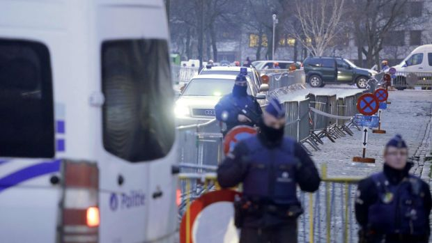 Police officers stand guard as vehicles arrive at the Palais de Justice courthouse in Brussels, on Monday. Photograph: Thierry Roge/AFP/Getty Images