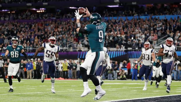 Nick Foles catches a touchdown pass during the first half.