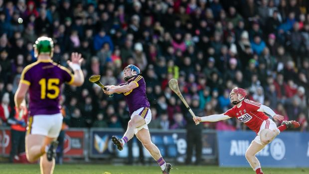 Wexford's Kevin Foley scores a point against Cork. Photograph: Laszlo Geczo/Inpho