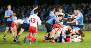 Tempers flare between the Dublin and Tyrone players at Healy Park on Saturday night. Photograph: Philip Magowan/Inpho