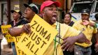 Supporters of African National Congress deputy president Cyril Ramaphosa chant slogans outside the party headquarters in Johannesburg on Monday. Photograph: Marco Longari/AFP/Getty Images