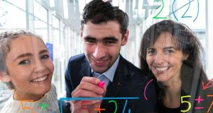 Caolann Brady, overall SciFest winner 2016, Christopher Carragher, overall SciFest winner 2014, and Margie McCarthy, head of education and public engagement at Science Foundation Ireland. Photograph: Shane O'Neill, SON Photographic