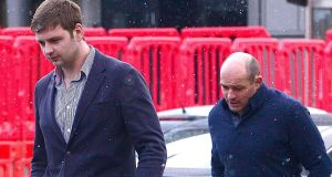 A picture from last week showing rugby players Ian Henderson (left) and Rory Best outside Belfast Magistrate's Court. Court was told Mr Best attended the hearing because he was instructed to be present by lawyers involved in the case. Photograph: Pacemaker